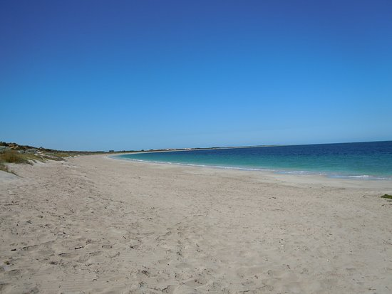 Warnbro Beach, near Rockingham. Wonderful stretch of clean sand with warm Indian ocean waters. Can be windy in the afternoon so go early. Official 'clothes optional' section is certainly worth a visit.