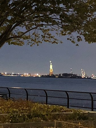 The view of the Statue of Liberty from Wagner Park at night. Gorgeous.