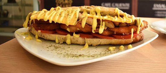 Cosmo Beans Cafe: crispy chicken sandwich with tomato, mushrooms and cheddar