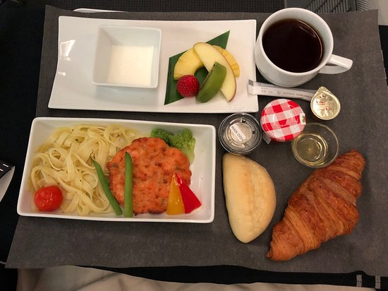 Japan Airlines: Western breakfast - salmon patty and pasta, also special coffee blend served only on board in business class