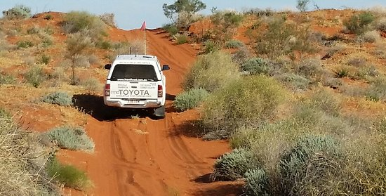 Travel West: Cross the Simpson Desert with experienced tour guides.
