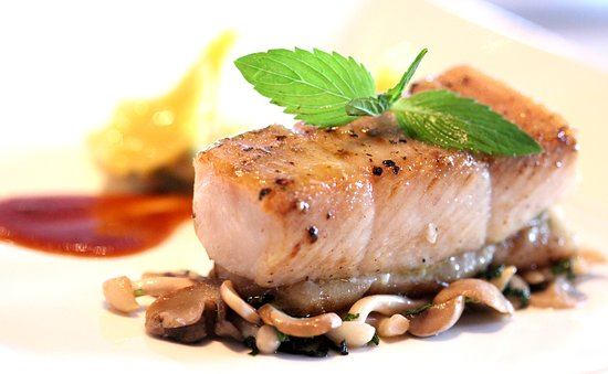 "Signature Restaurant: Baked ""ca loc"" fish (snakehead) Seafood and spinach bonbon, sautéed mushrooms, pepper, teriyaki sauce"
