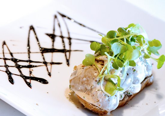 Signature Restaurant: Lamb kidneys Sautéed mushrooms, grain mustard cream, grilled sourdough