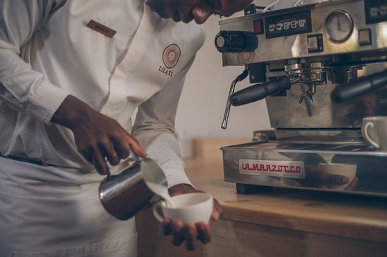 Bruce one of our Lilayi waiters making a fresh cappuccino.