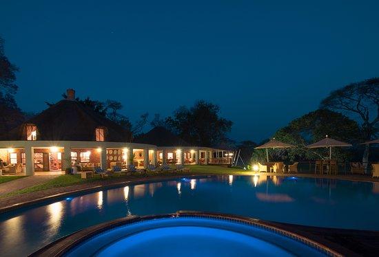 Pool - Lilayi Lodge: Lodge and pool area at night