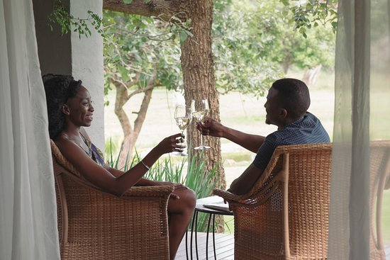 Enjoy a glass of our house wine from the comfort of your Lilayi Chalet verandah.