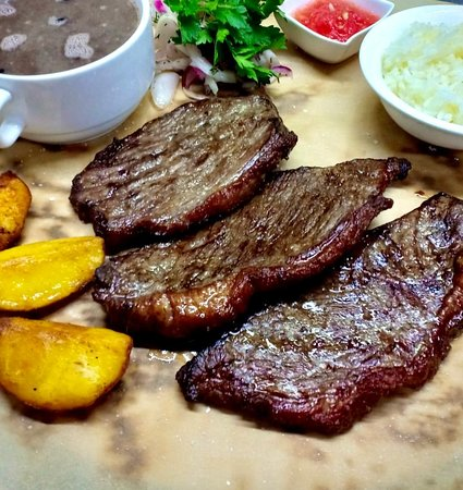 Traditional Brazilian meal,  steaks with black beans and rice.