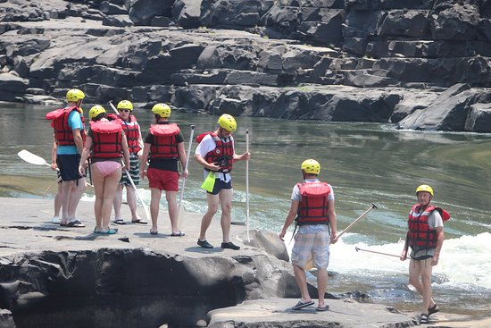 Водопад Виктория, Замбия: Clients looking on the Commercial suicide rapid. A class 6 rapids, for safety reasons we do not run this rapid.