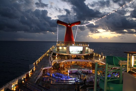 Caraibi: The Sun Setting And Lights Turning On While Enjoying Our Amazing Caribbean Cruise With Carnival Cruise Lines.