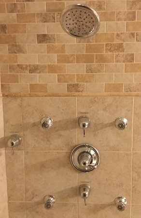 The Puget sound suite oversized shower with six shower heads for that extra fresh and relaxing feeling