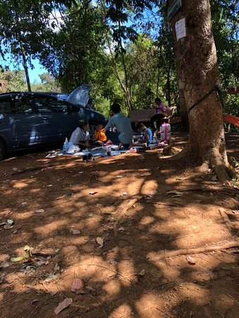 Kachang Waterfall: Locals enjoying a picnic at the car park.