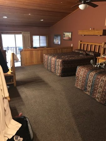 Room has two queen beds, desk, dresser, tv.  It also has a small kitchenette with microwave and mini fridge and a sofa bed and kitchen table.