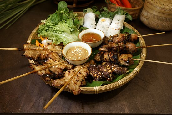 Mekong Special - Barbeque meat platter. Three servings of pork skewers, chicken skewers, and grilled beef. Served with fresh vegetables, mint leaves wrapped with fine rice vermicelli, Vietnamese peanut sauce and fish sauce with chilli bits. $24.90++
