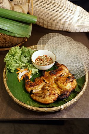 Mekong Special - Signature hand-pulled grilled spring chicken served with fresh vegetables, paper rice, and spicy herb salt. $18.80++