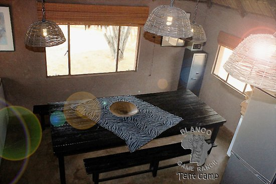 Blanco Hunting Safaris-tent camp: Internal  view communal kitchen/dining area. Fully furnished and stocked with amenities for a comfortable stay. Ample freezer, cooling space. Has own geyser and urn.