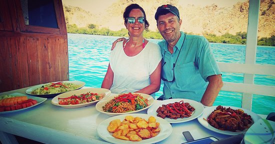 The english brother and sister explore komodo 3days 2night, enjoy with the food, they look hungry, after snorkeling. Enjoy the big meals of the day .