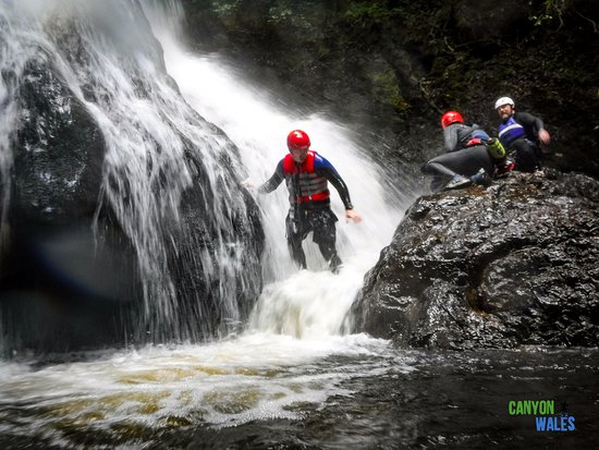 Feeling the power of the water in the main waterfall, Level 2 trip in the Afon Ddu