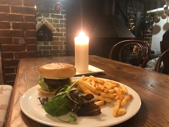 Loxwood, UK: The Onslow Burger, freshly prepared with beef from our local butcher served in a brioche bun, cheese, bacon, salad and choice of sweet potato, skinny or chunky chips