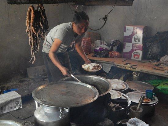 Inside of morong, preparing food (rice, pork etc)