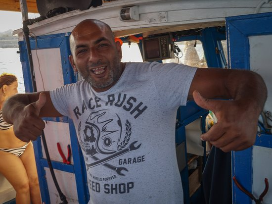 Makarounas Fishing Trip Rhodes: Lovely fishermen on board, always ready to lend a hand. They were great with children too.