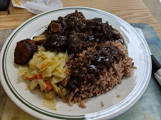 The most amazing Oxtail, rice and peas, steamed cabbage and plantains