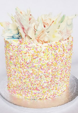 5 layered rainbow cake with white chocolate shards filled with vanilla buttercream