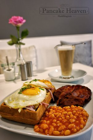 Haddington, UK: Savory waffle with ham, cheddar, fried eggs, bacon and  baked beans.