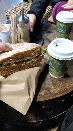 Humongous Salmon Sandwich with coffee next to their fireplace