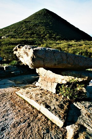 Iron Mountain: This isTable Rock.  The pedestal is dramatic and without it, Table Rock would be not so interesting.  The conical peak in the background makes this a great place to take photos.  I need to return some other time, when the morning sky is blue.  Perhaps it will be blue in the summer.  I took this photo in Nov. 2018.  --Tom Brody