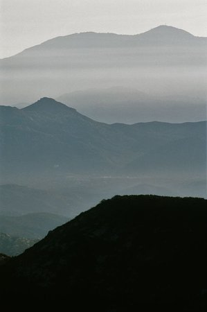 Photo from Iron Mountain Trail, using 300 mm telephoto lens and Ektar 100 color film.   In this image, there are three horizons, but in my other photo posted here, with the lens pointing in a slightly different direction, there are five horizons. --Tom Brody
