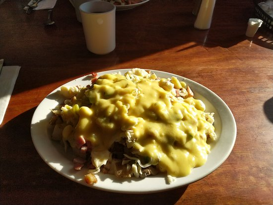 Breakfast poutine - glorious. Portion size enough to feed a family of four.
