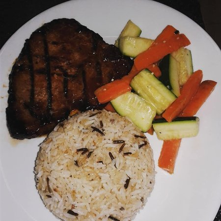 Pork Chop served with fresh cooked veggies and garlic rice