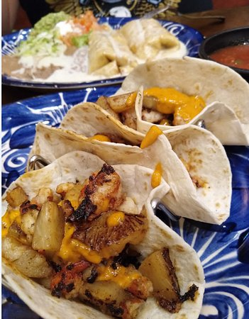 Springdale, OH: Trio of Seafood Tacos with fresh grilled pineapple and chipotle sauce; duo of shredded chicken Chimichangas with cheese sauce.