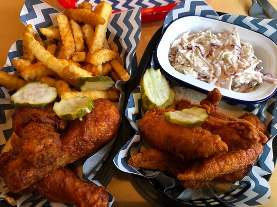 Chicken drumsticks with fries and tenders with coleslaw