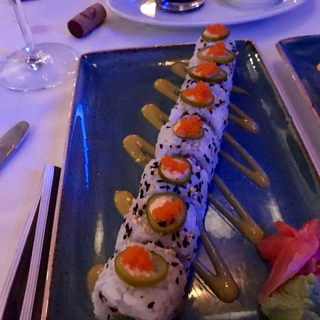 Shows a big plate of sushi