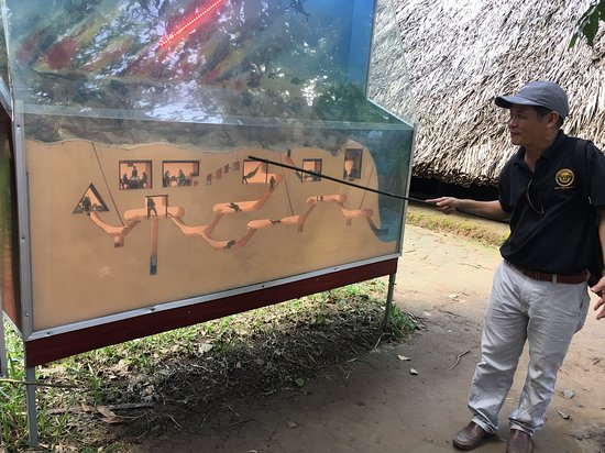Cu Chi Tunnels & Mekong Delta Full-Day VIP Tour from Ho Chi Minh city: Foo taking us to school on the Cu Chi tunnels.