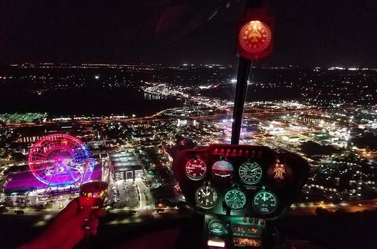 Vol en hélicoptère de nuit au-dessus...