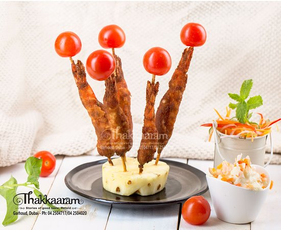 Crunchy Fried Prawns!   Gently spiced king prawns in a special coating make an impressive but simple starter or light lunch. Absolutely delicious with the best ingredients from Thakkaaram- Thakkaaram Dubai  #Thakkaaram #Garhoud #Dubai #Tastyfood #BestFood #Keralafood #Malabarfood #Fusion #Tastylife #Foodlover