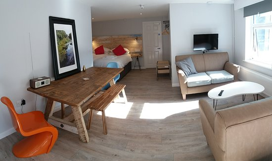 Five Valleys Aparthotel : Apartment 2 is open plan and the table can seat 10, so if you're travelling with friends, and you'd like to be able to sit together, do let us know and we'll do our best to allocate this room to you.