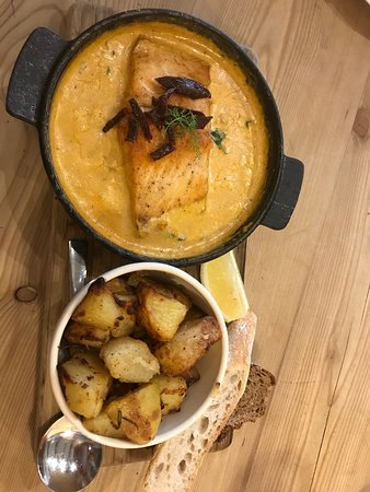Tuscan salmon served with roasted potatoes wedges