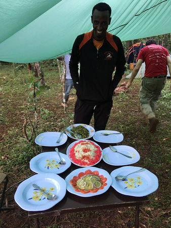 Such was our typical lunch in forest :) and the proud cook Idris nect to it  (if you travel with Armaye, I recommend to ask can Idris be your cook! cool guy and professional at his work. he also speaks good english! :) )