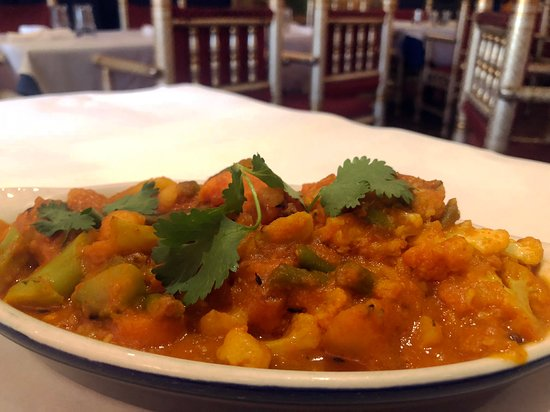 Nirvana Indian Cuisine: Veggie Curry Vegetables cooked in a thick, spicy and tangy gravy