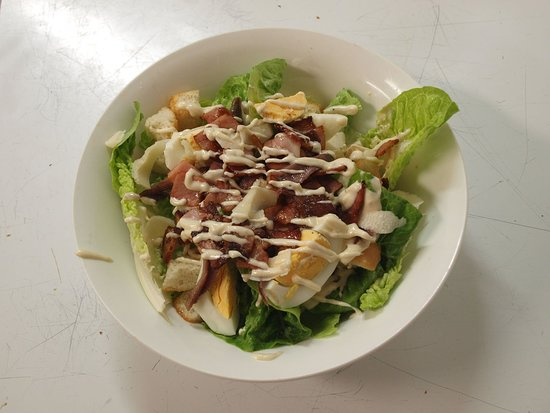 Caesar Salad - delicious! They make their own dressing too
