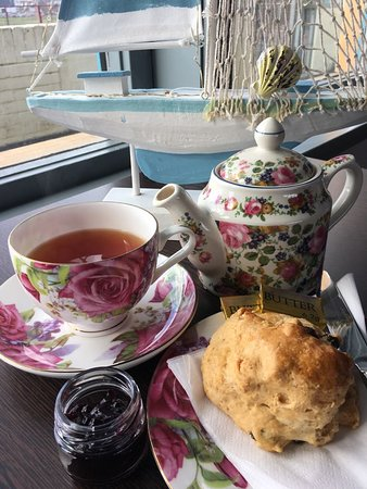 Freshly baked scones and tea served in China tea sets