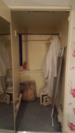Eastwell Manor: Wardrobe with rain macs but no bathrobes