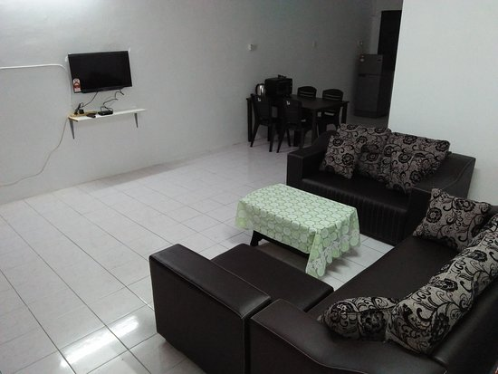 Living room and dining area are fully furnished.