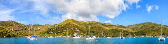 Panoramic view of a harbor with anchored sailboats in BVI