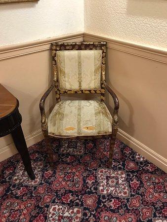 Threadbare chair in hallway