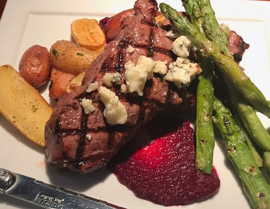 Bistecca Fiorentina - 10 oz. N.Y. Strip steak grilled, served over seasonal root vegetable puree and topped with gorgonzola dolce. Accompanied with oven-roasted potatoes and asparagus