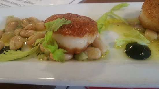 Scallops Alla Contadina - Pan-seared scallops accompanied by cannellini beans and garnished with squid ink aioli.